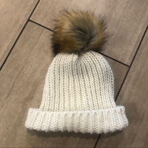 Winter beanie with faux fur poof